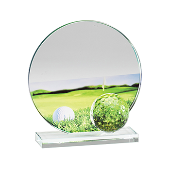 A Clear Circular Glass Award With an image of a Golf Course In The Background And a Glass Golf Ball Attached.
